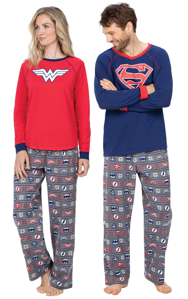 Models wearing Red and Blue Justice League Pajamas for Him and Her image number 0