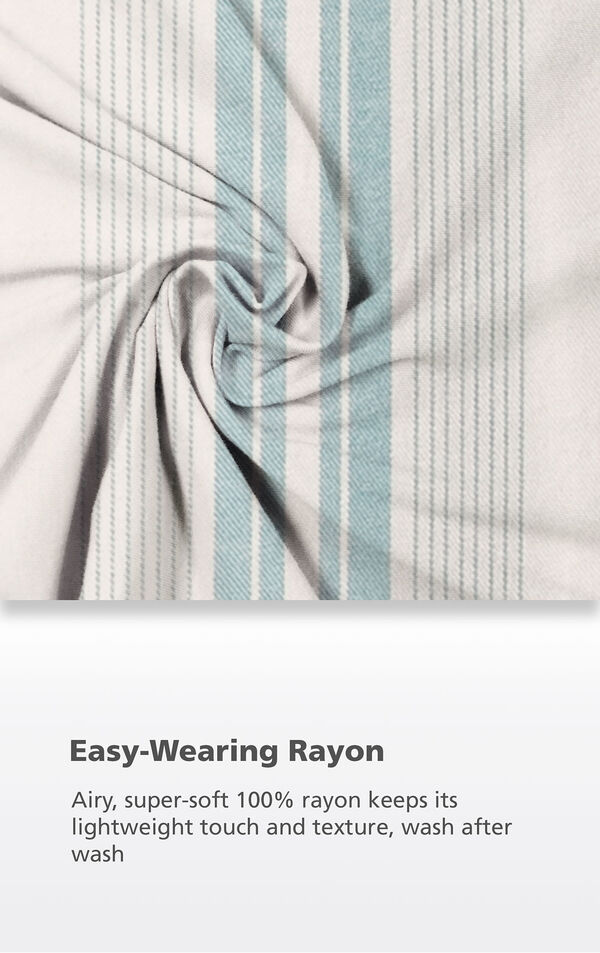 Blue and White Cabana Stripe fabric with the following copy: Airy, super-soft 100% rayon keeps its lightweight touch and texture, wash after wash image number 4