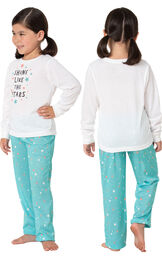Model wearing Aqua Stars PJ with Graphic Tee for Youth, facing away from the camera and then facing towards the side image number 1
