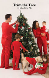 Family trimming the Christmas tree in matching Red Dropseat PJs image number 1