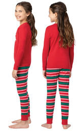 Model wearing Red and Green Christmas Stripe PJ - Kids, facing away from the camera and then to the side image number 1