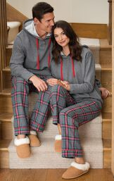 Couple sitting down wearing matching His and Hers Gray Plaid Hooded Pajamas image number 1