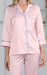 Close-up of button-front 3/4 sleeve pink top with light blue trim image number 4
