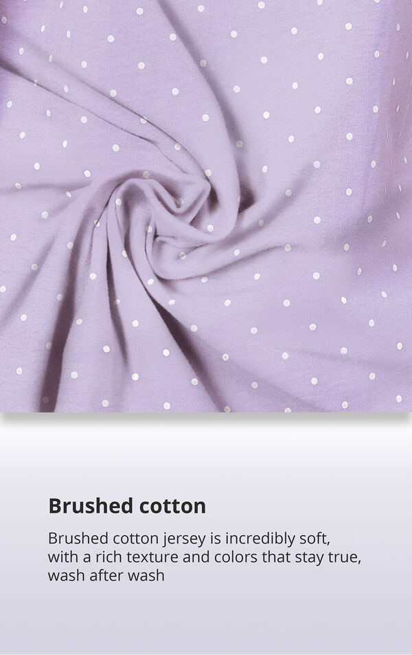 Purple Pin Dot Fabric Swatch with the following copy: Brushed cotton jersey is soft, inside and out. Machine washable cotton jersey won't fade or thin out. High-quality fabric means colors stay bright. Comfy mid-weight fabric is breathable. image number 5