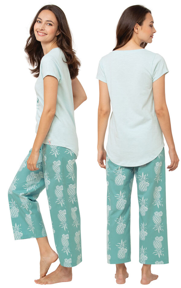 Model wearing Margaritaville Breezy Bedtime Pajamas - Turquoise, facing away from the camera and then facing to the side image number 1