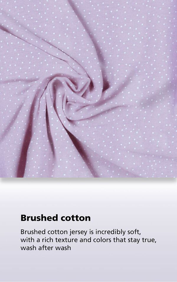 Purple Pin Dot Fabric Swatch with the following copy: Brushed cotton jersey is soft, inside and out. Machine washable cotton jersey won't fade or thin out. High-quality fabric means colors stay bright. Comfy mid-weight fabric is breathable. image number 3