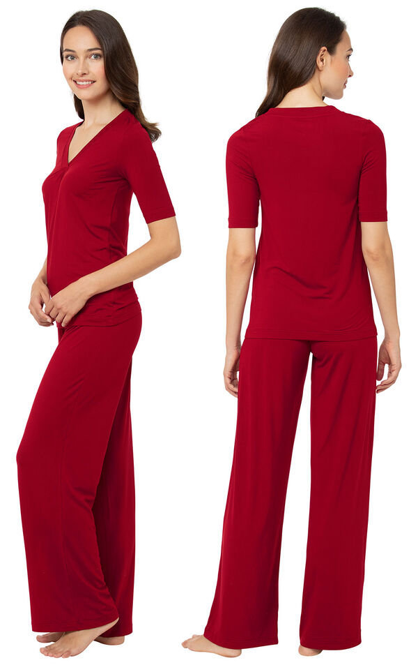 Model wearing Naturally Nude Pajamas - Ruby Red, facing away from the camera and then facing to the side image number 1