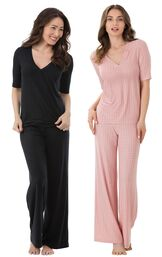 Models wearing Naturally Nude Pajamas - Solid Black and Naturally Nude Pajamas - Pink.
