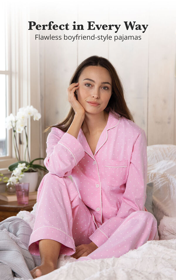 Model wearing Pink Pin Dot Button-Front PJ for Women sitting on bed image number 3