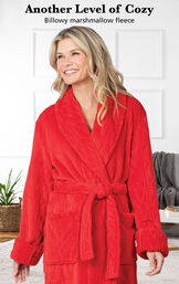 Model wearing Red Cable Embossed Fleece Marshmallow Robe with this copy: Another level of cozy. Billowy marshmallow fleece. image number 2