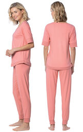 Model wearing Coral Jogger PJ for Women, facing away from the camera and then to the side image number 1