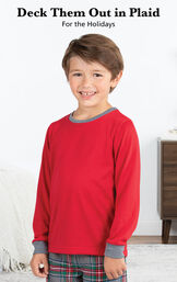 Boy wearing Gray Plaid Boys Pajamas by bed with the following copy: Deck Them Out in Plaid for the Holidays. image number 2