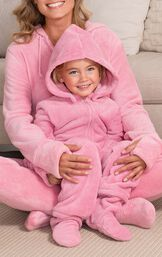 Mom and toddler wearing matching pink onesies image number 1
