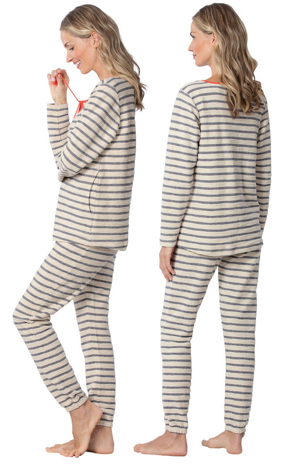 Model wearing Blue and White Stripe PJ with Coral Tie Neck for Women, facing away from the camera and then to the side image number 1