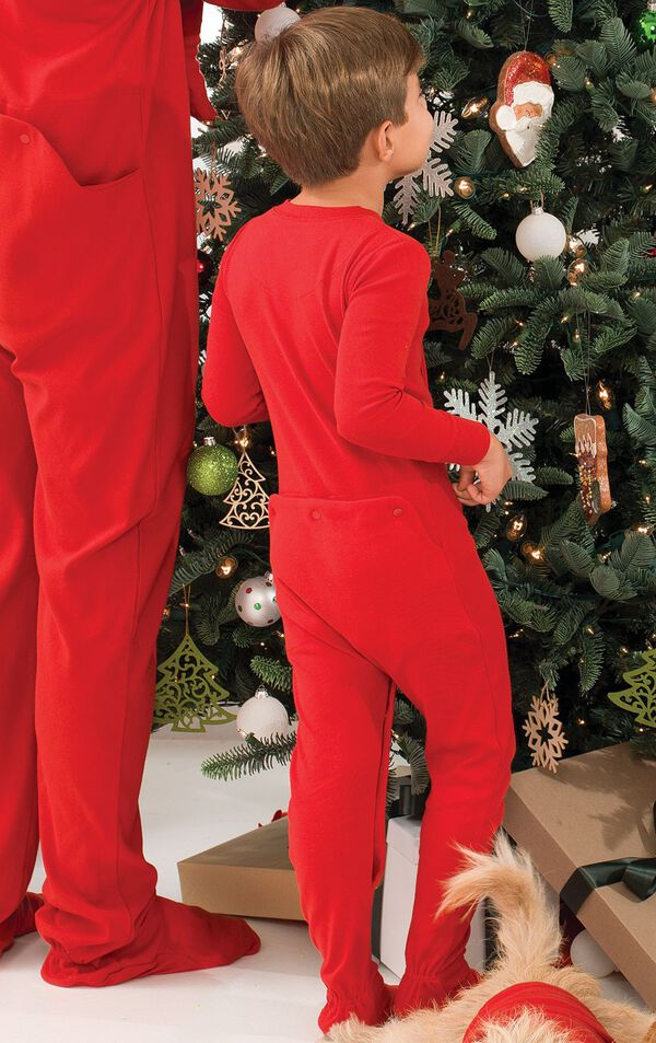 Toddler Boy wearing Red Dropseat PJs, decorating the Christmas tree image number 2