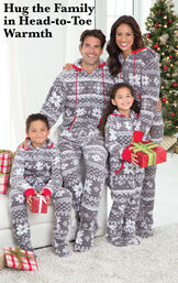 Parents and Kids wearing Gray Nordic Fleece Hoodie-Footie Matching Family Pajamas by the Christmas tree. Headline: Hug the Family in Head-to-Toe Warmth. image number 1