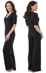 Model wearing Black Stretch Knit PJ for Women, facing away from the camera and then facing to the side image number 1