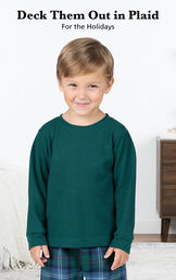 Toddler boy wearing Heritage Plaid Thermal-Top Pajamas by bed with the following copy: Deck them out in plaid for the holidays image number 2
