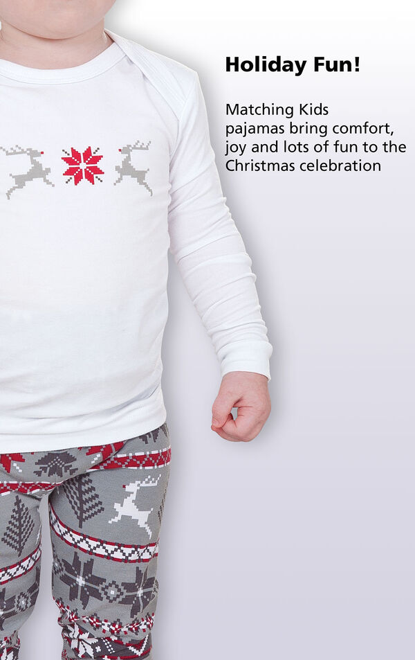Close-up of Long-sleeve top with the following copy: Holiday fun! Matching Kids pajamas bring comfort, joy and lots of fun to the Christmas celebration image number 1