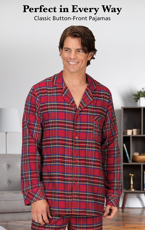 Model wearing Stewart Plaid Flannel Button-Front Men's Pajamas by couch with the following copy: Perfect in Every Way, Classic Button-Front Pajamas image number 2