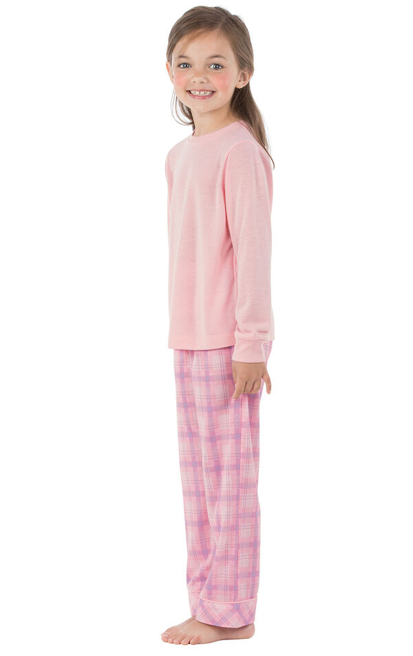 Model wearing Pink Plaid PJ for Youth, facing away from the camera and then facing towards the side image number 1