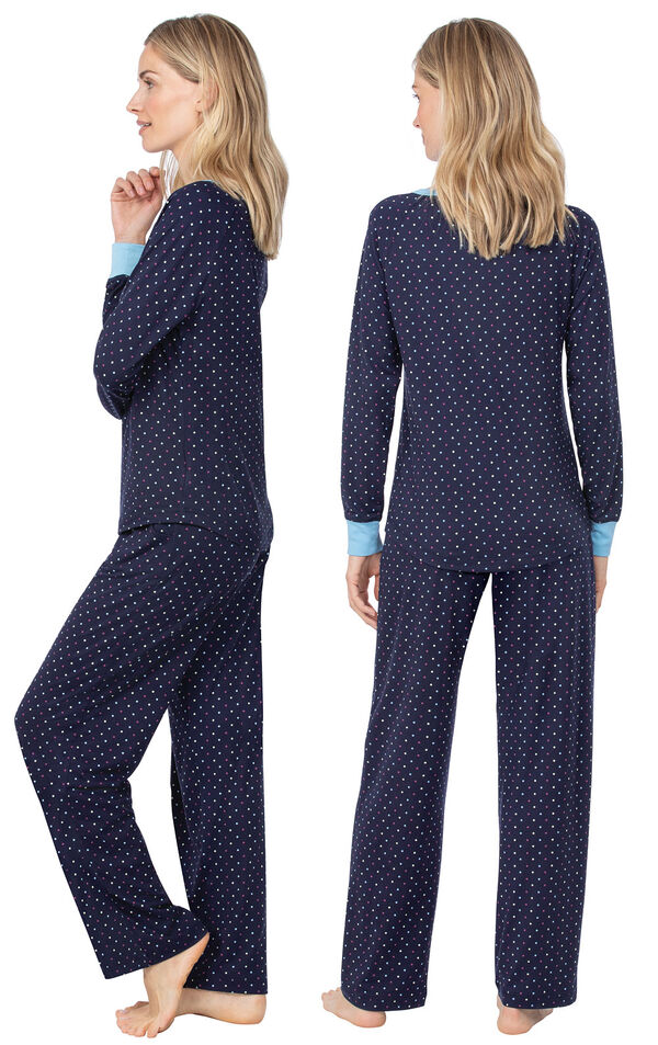 Model wearing Whisper Knit Henley Pajamas - Navy with Dots, facing away from the camera and then to the side image number 1