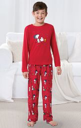 Model standing by couch wearing Red Snoopy and Woodstock Boys' Pajamas image number 1