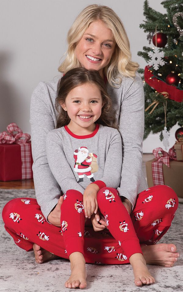 Mom and Toddler wearing matching gray and red St. Nick Pajamas, sitting by Christmas Tree image number 5