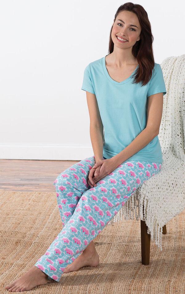 Model sitting on chair wearing Aqua Floral V-neck Short-Sleeve PJ for Women with Modern Floral Full-length pants image number 3