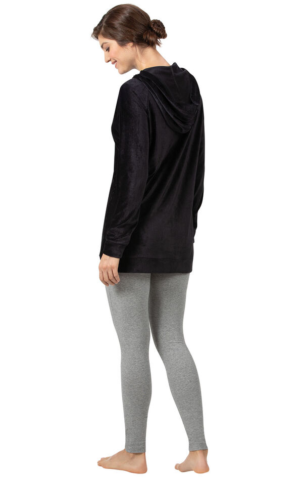 Model wearing Black Ribbed Velour Hoodie Legging Pajamas for Women, facing away from the camera image number 1