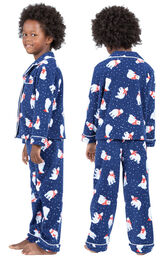 Model wearing Navy Polar Bear Fleece Button-Front PJ for Kids, facing away from the camera and then facing to the side image number 1