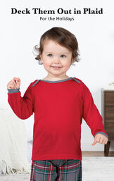Infant wearing Gray Plaid Infant Pajamas by bed with the following copy: Deck Them Out in Plaid for the Holidays. image number 2