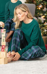 Model playing with blocks wearing Green and Blue Heritage Plaid PJs image number 1