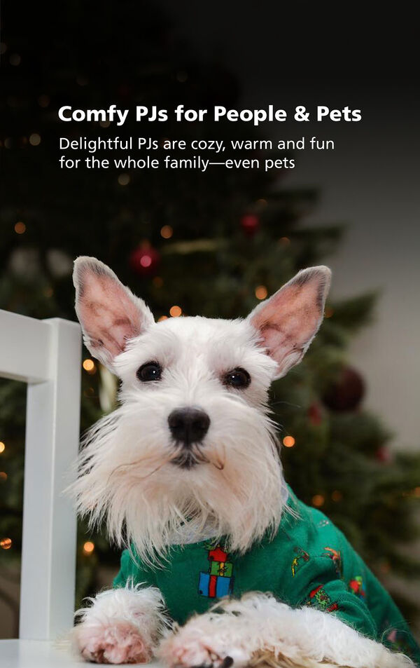 Dog in front of Christmas Tree wearing green Grinch PJs with the following copy: Comfy PJs for People and Pets - delightful PJs are cozy, warm and fun for the whole family- even pets image number 2