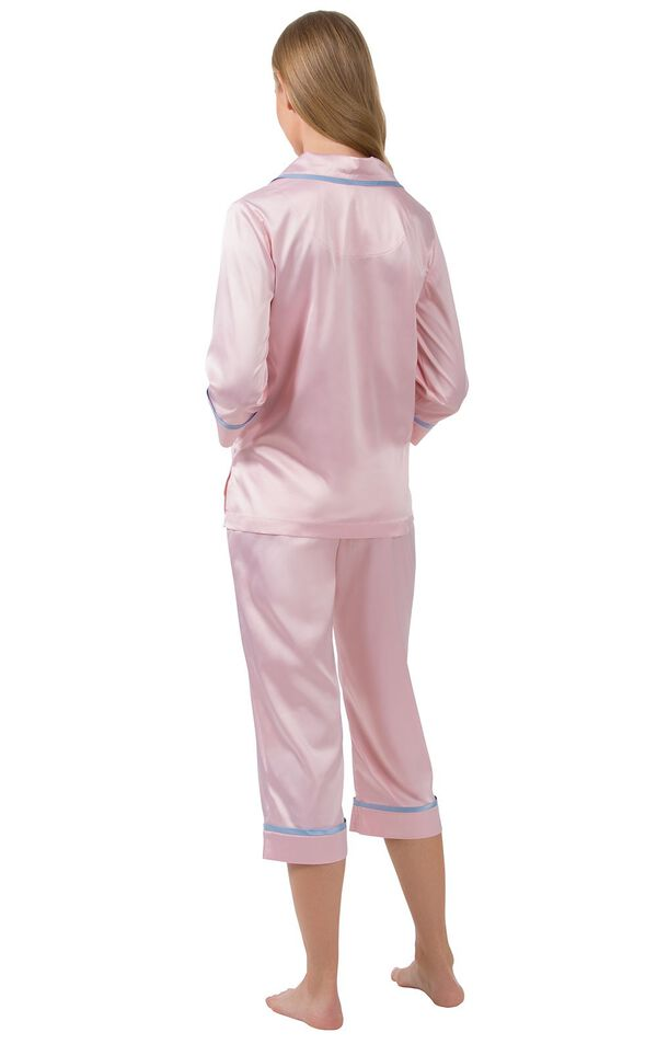 Model wearing Light Pink Satin Button-Front Capri PJ with Blue Trim for Women, facing away from the camera image number 1