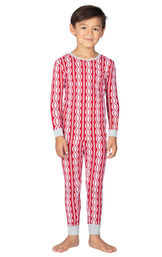 Model wearing Red and White Peppermint Twist PJ for Kids
