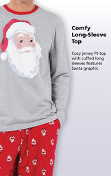 Close-up of St. Nick Men's Pajamas Comfy Long-Sleeve Top with the following copy: Cozy jersey PJ top with cuffed long sleeves features a Santa graphic image number 2