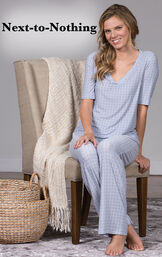 Model sitting on a chair wearing Nudies Pajamas - Blue with the following copy: Next-to-nothing. image number 2