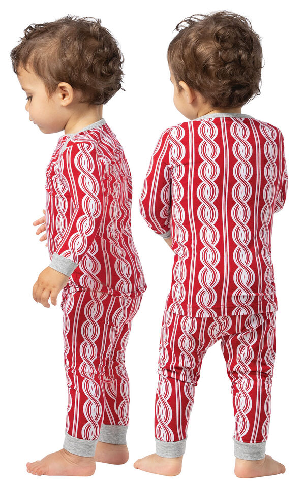 Model wearing Red and White Peppermint Twist PJ for Infants, facing away from the camera and then to the side image number 1