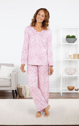 Model standing by couch wearing Pink Print Tie-Neck PJ for Women by Addison Meadow and PajamaGram image number 2