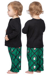 Model wearing Black and Green Snowman Argyle Henley PJ for Infants, facing away from the camera and then to the side image number 1