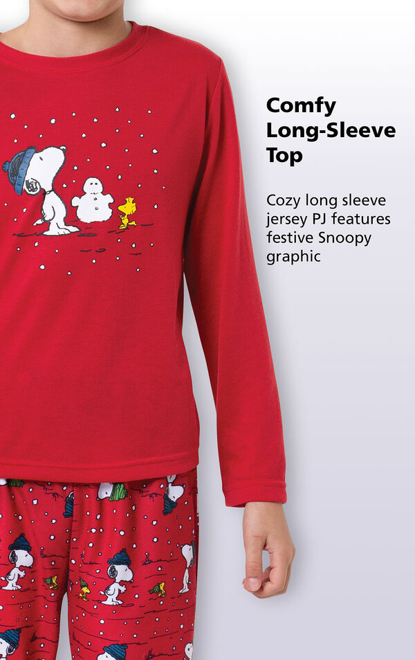 Close-up of comfy red long-sleeve top with the following copy: Cozy long sleeve jersey PJ features festive Snoopy graphic. image number 1