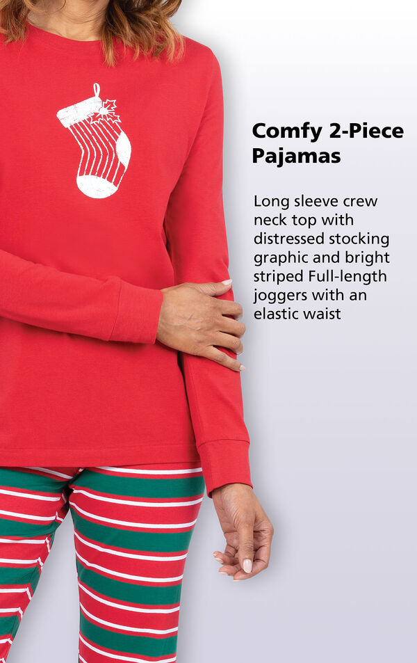 Women's Red and Green Christmas Stripe PJs have a long sleeve crew neck top with distressed stocking graphic and bright striped full-length joggers with an elastic waist image number 2