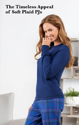 Model wearing Indigo Plaid Jersey-Top Flannel Pajamas by chair with the following copy: The timeless appeal of soft plaid PJs image number 2