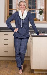 Model standing in kitchen wearing heathered blue Solstice Shearling Rollneck Pajama Set image number 2