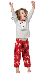 """Toddler with his arms waiving in excitement wearing Red Star Wars Pajamas with """"Up To Snow Good"""" printed on the top image number 2"""