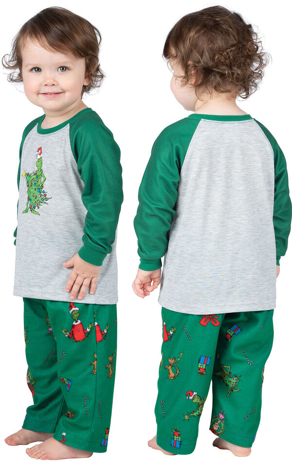 Infant wearing green and gray Dr. Seuss' The Grinch™ Pajamas, facing away from the camera and then facing to the side image number 1