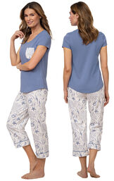 Model wearing Blue and White Seashell PJs for Women with Pocket Short-Sleeve Tee and matching Capris, facing away from the camera and then facing to the side image number 1