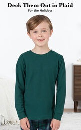 Boy wearing Heritage Plaid Thermal-Top Pajamas by bed with the following copy: Deck them out in plaid for the holidays image number 2
