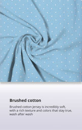 Blue Polka Dot Fabric Swatch with the following copy: Brushed cotton jersey is soft, inside and out. Machine washable cotton jersey won't fade or thin out. High-quality fabric means colors stay bright. Comfy mid-weight fabric is breathable. image number 5